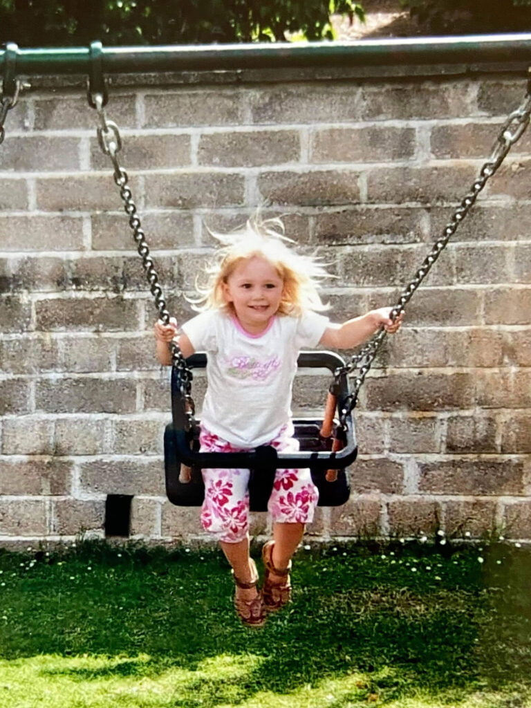 Child playing on a swing